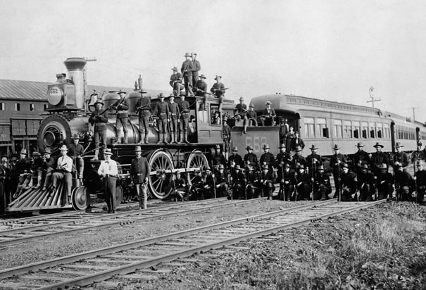 Infantry Company Poses Beside Train