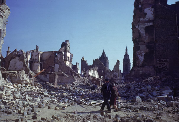 Couple Walk Through Ruins of St. Lo France